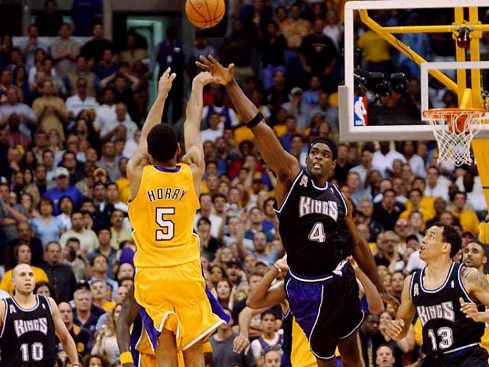 Robert Horry hits a three-pointer over Chris Webber at the buzzer   Photo courtesy of STAPLES Center/Bernstein Associates