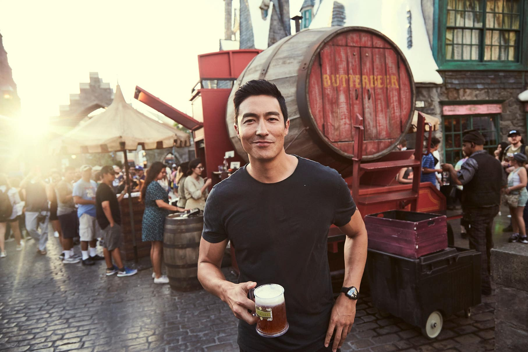 Daniel Henney enjoys a Butterbeer™ at The Wizarding World of Harry Potter™