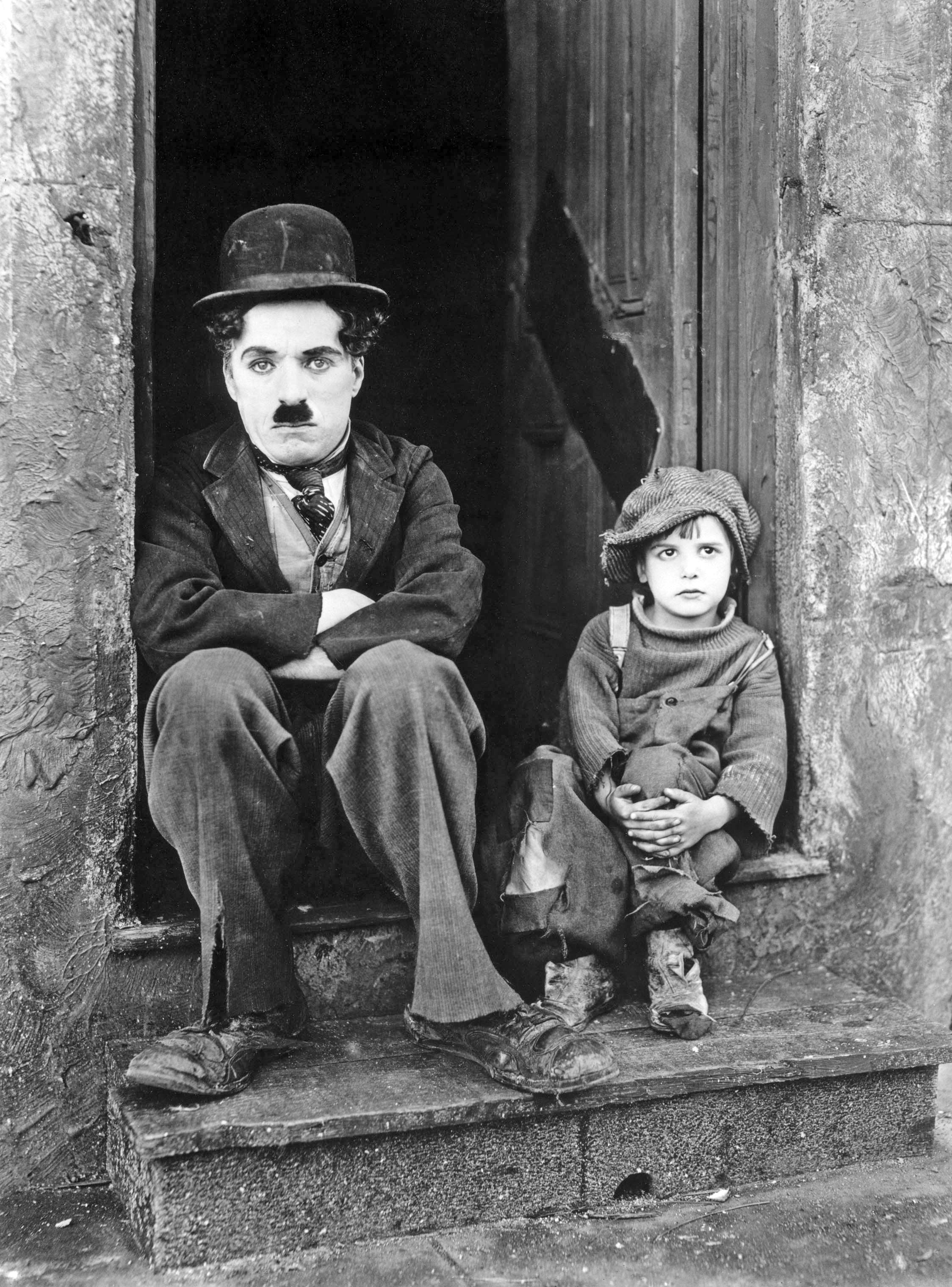 "Charlie Chaplin and Jackie Coogan in ""The Kid"" (1921)"