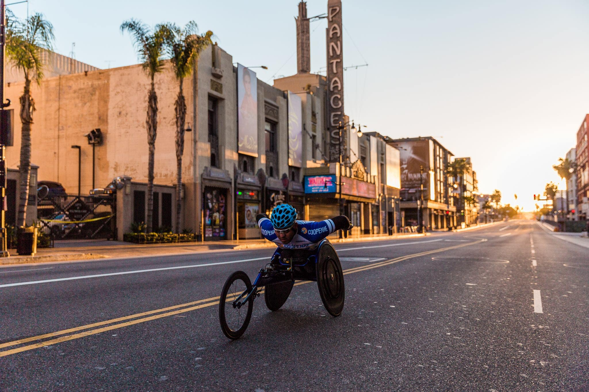 LA Marathon wheelchair racer passes the Pantages Theatre