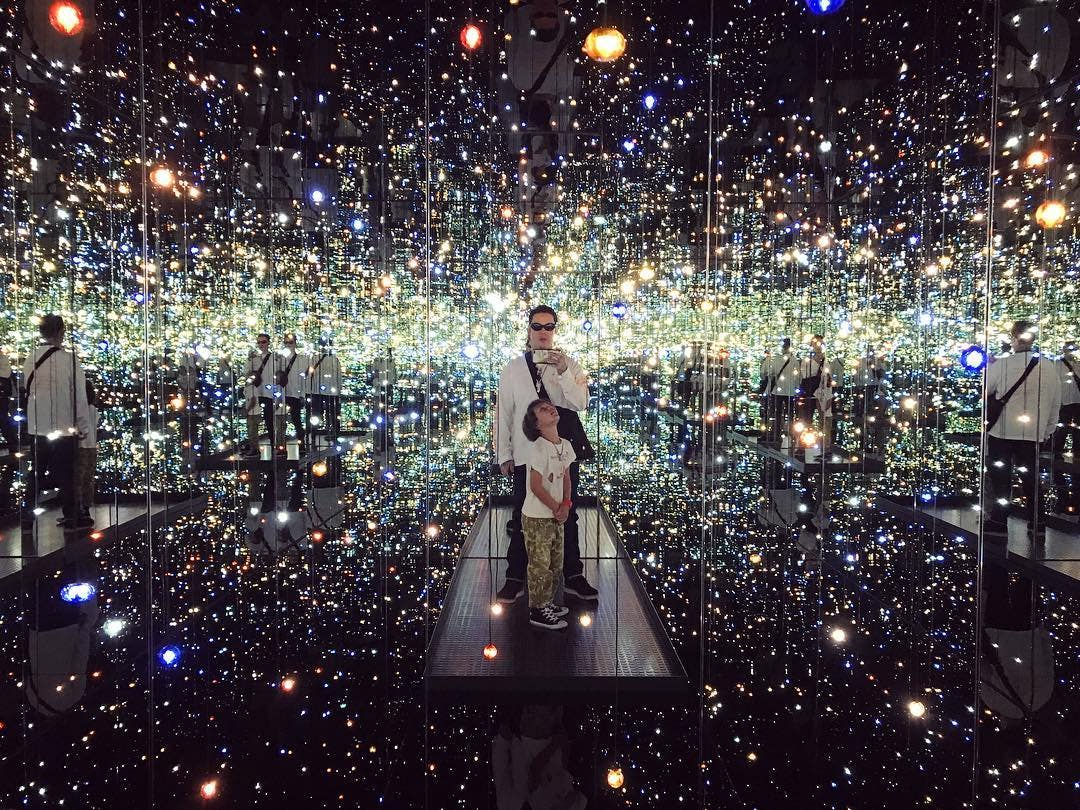 """Dr. Woo and his son inside Yayoi Kusama's """"Infinity Mirrored Room"""" at The Broad"""