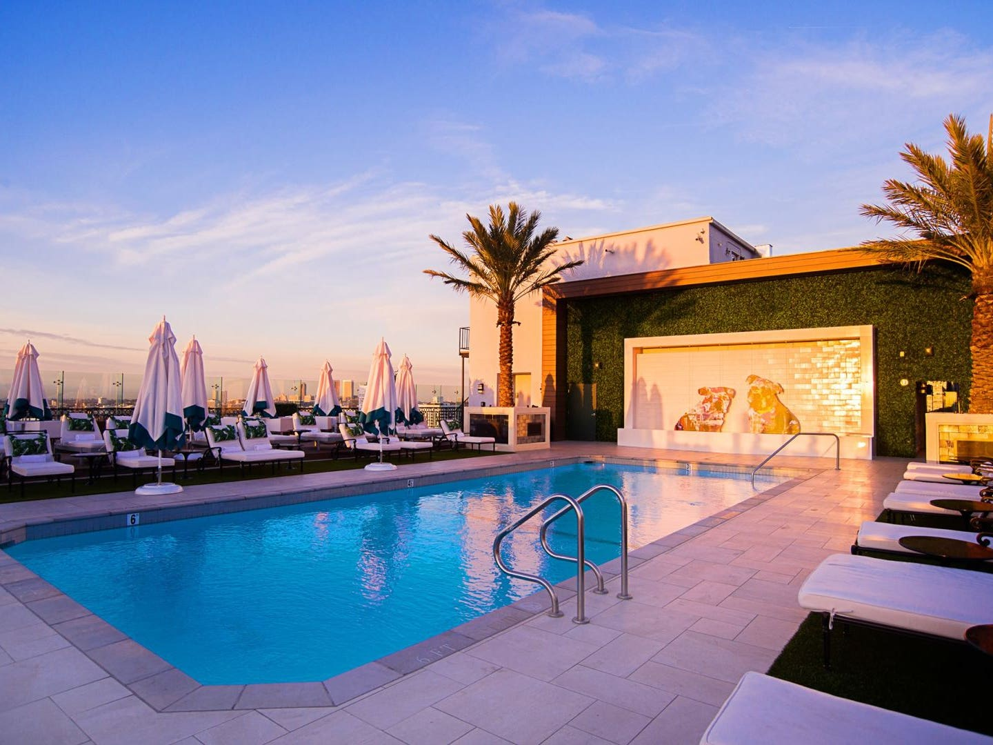 The London West Hollywood rooftop pool at sunset