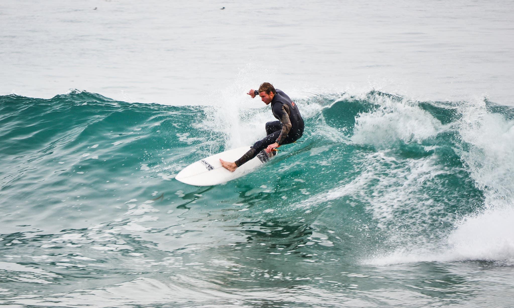 Surfer at Zuma Beach