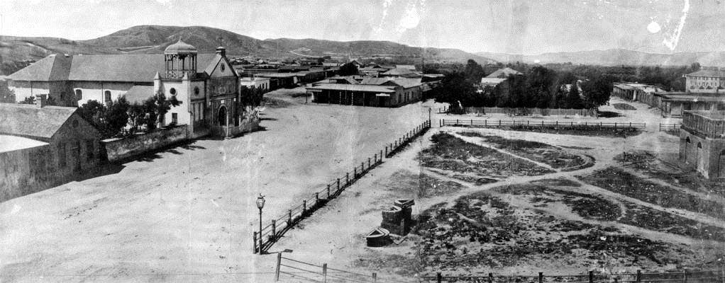 Panoramic view of Los Angeles Plaza and Old Plaza Church in 1869