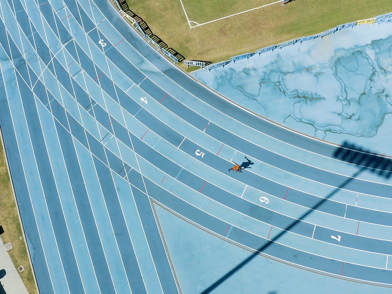 Aerial view of Blake Leeper running at UCLA Drake Stadium