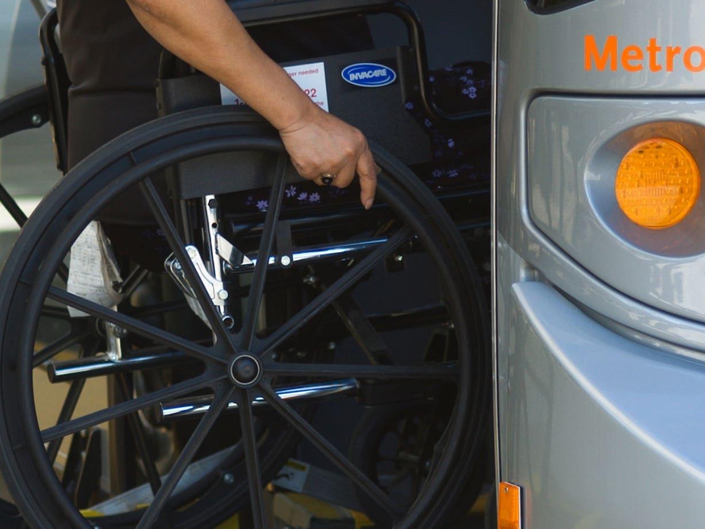 Rider in wheelchair boarding a Metro Orange Line bus