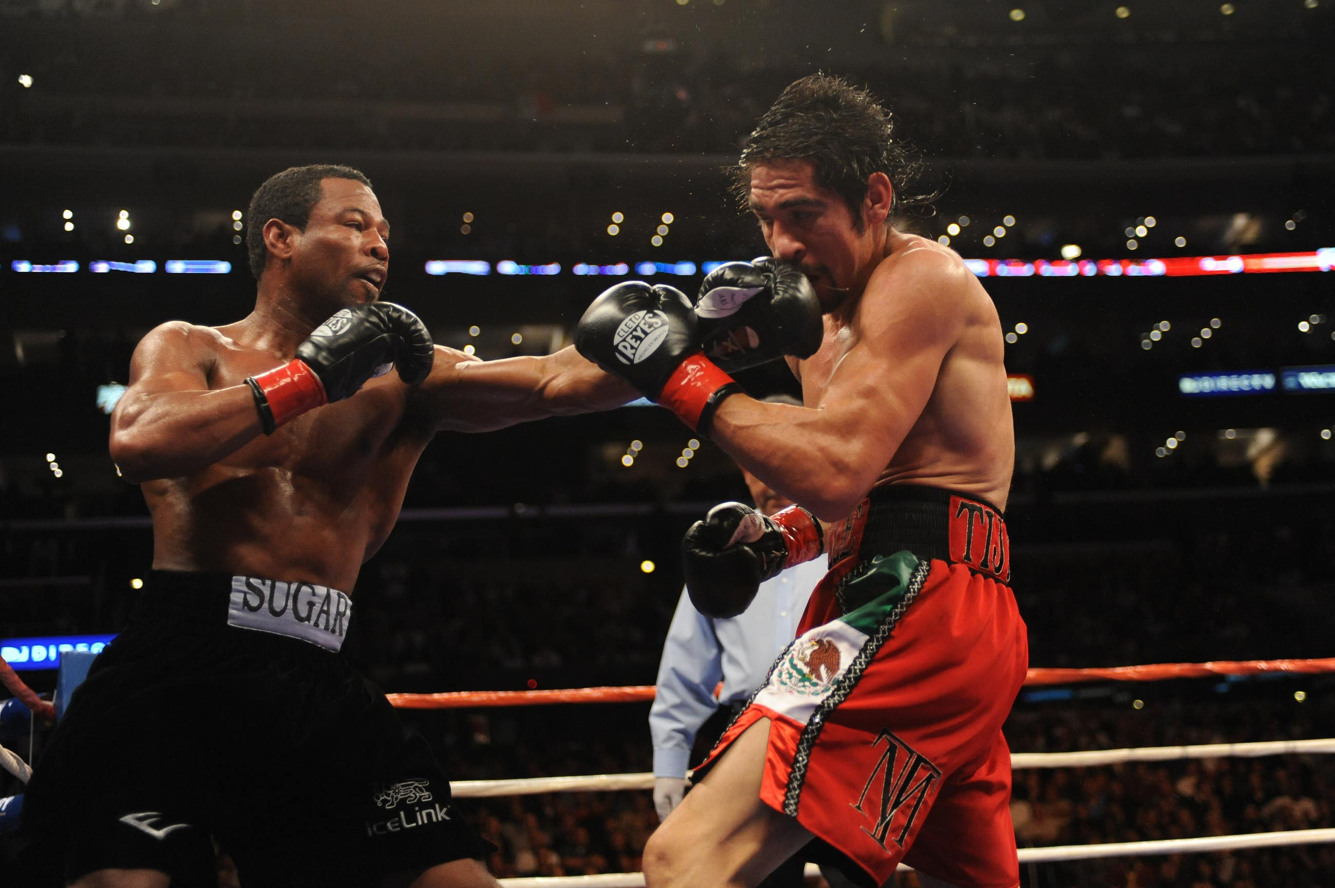 """""""Sugar"""" Shane Mosely lands a punch on Antonio Margarito at STAPLES Center"""