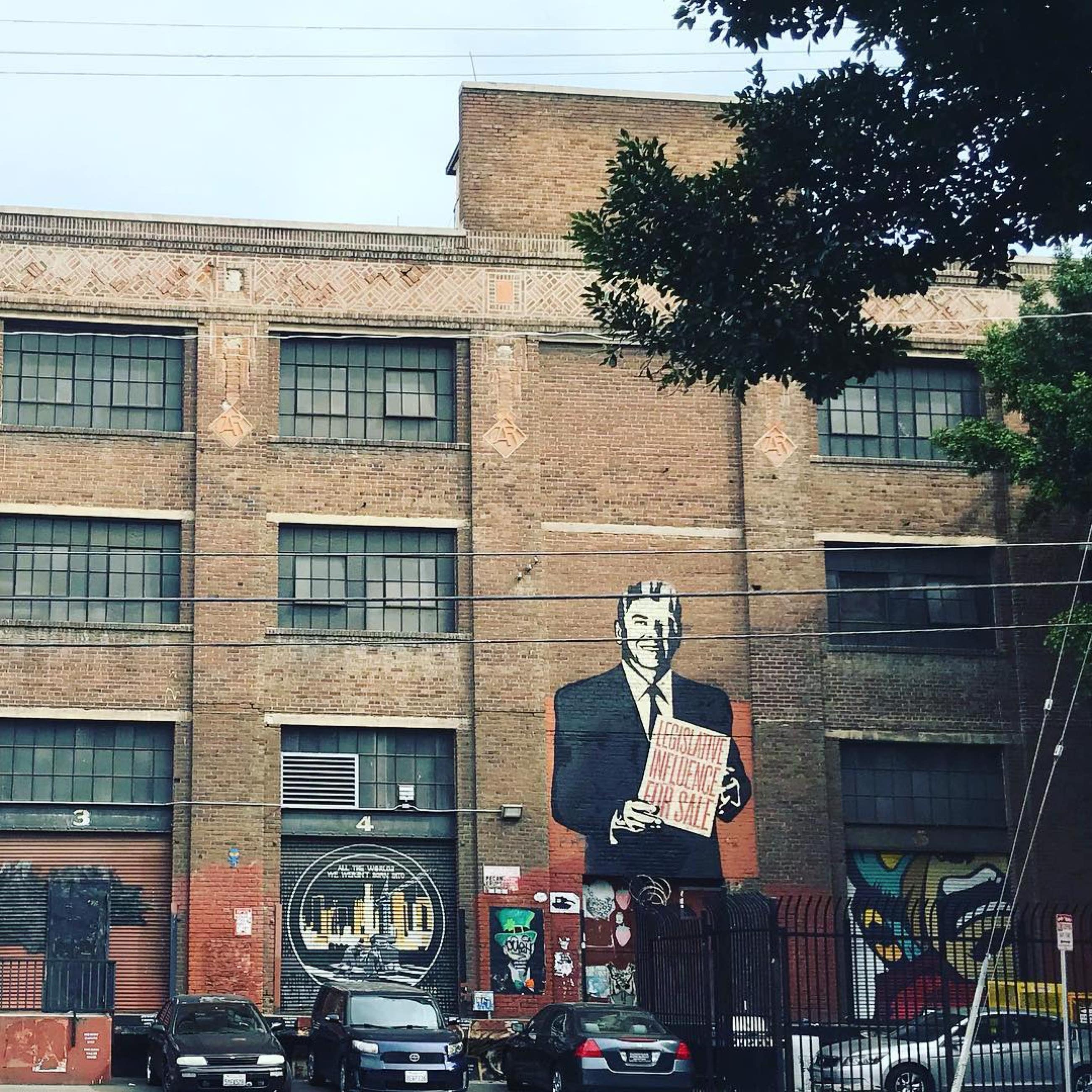"""Legislative Influence for Sale"" by Shepard Fairey viewed from Alameda Street 