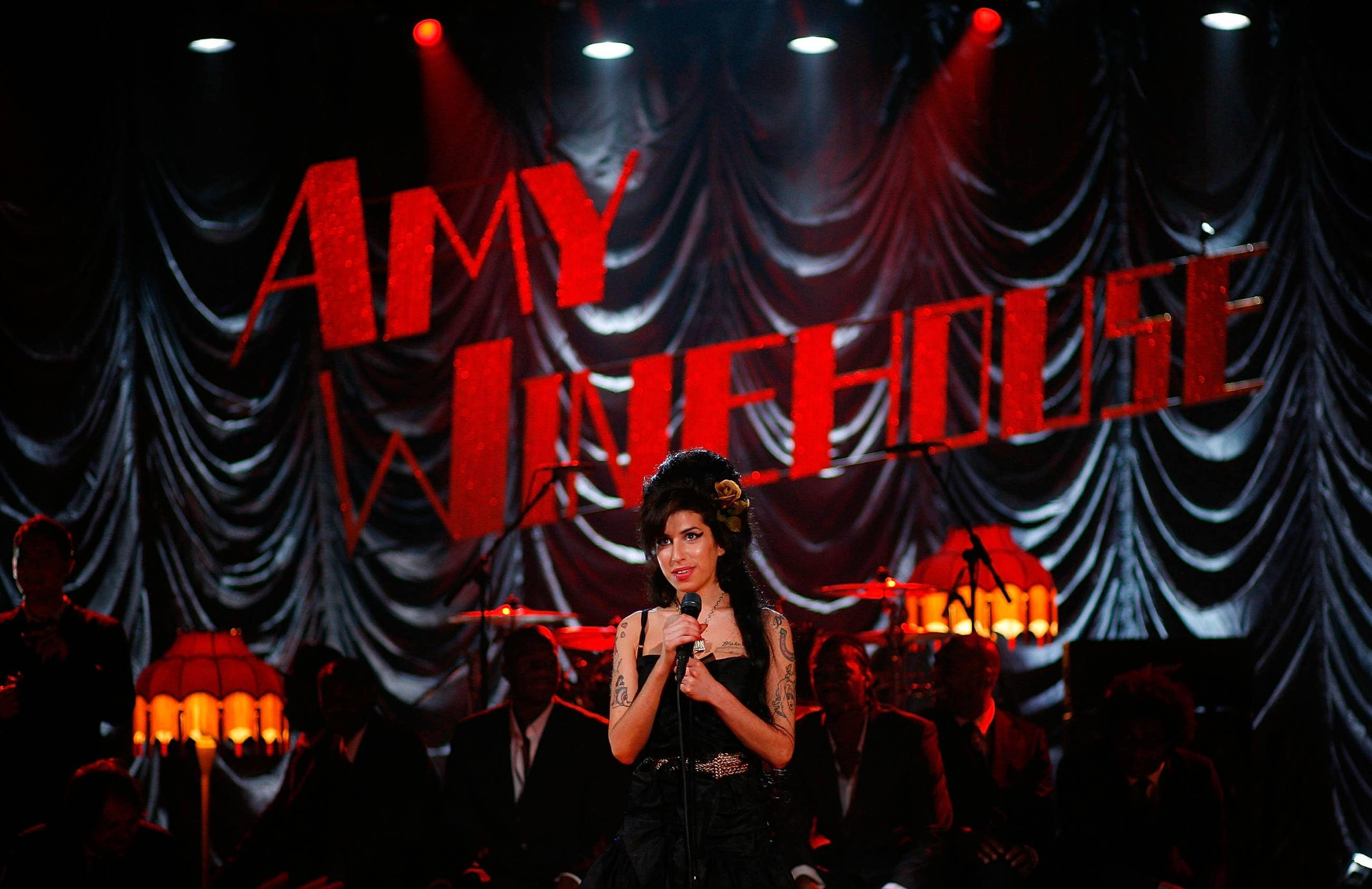 Amy Winehouse performs at the 50th GRAMMY Awards live via satellite from London