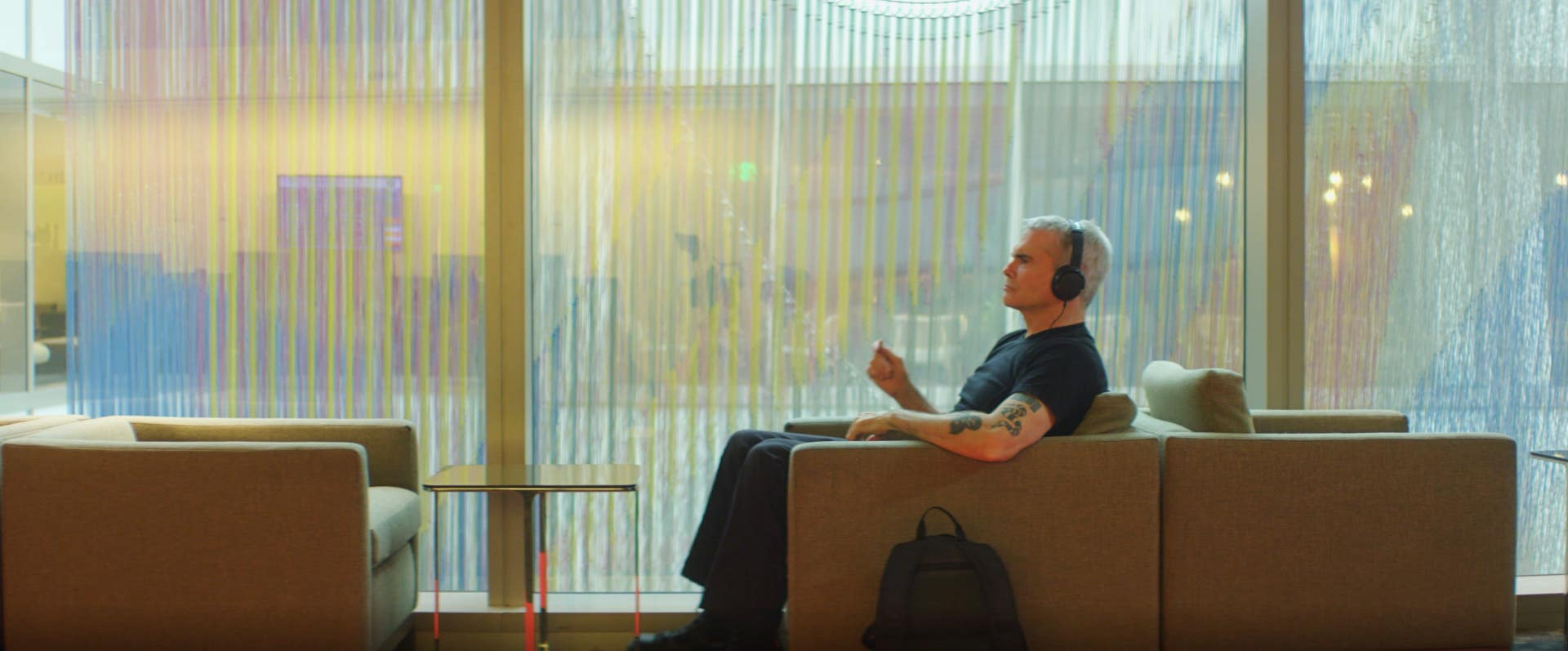Henry Rollins relaxes with headphones in the Executive Lounge at LAX