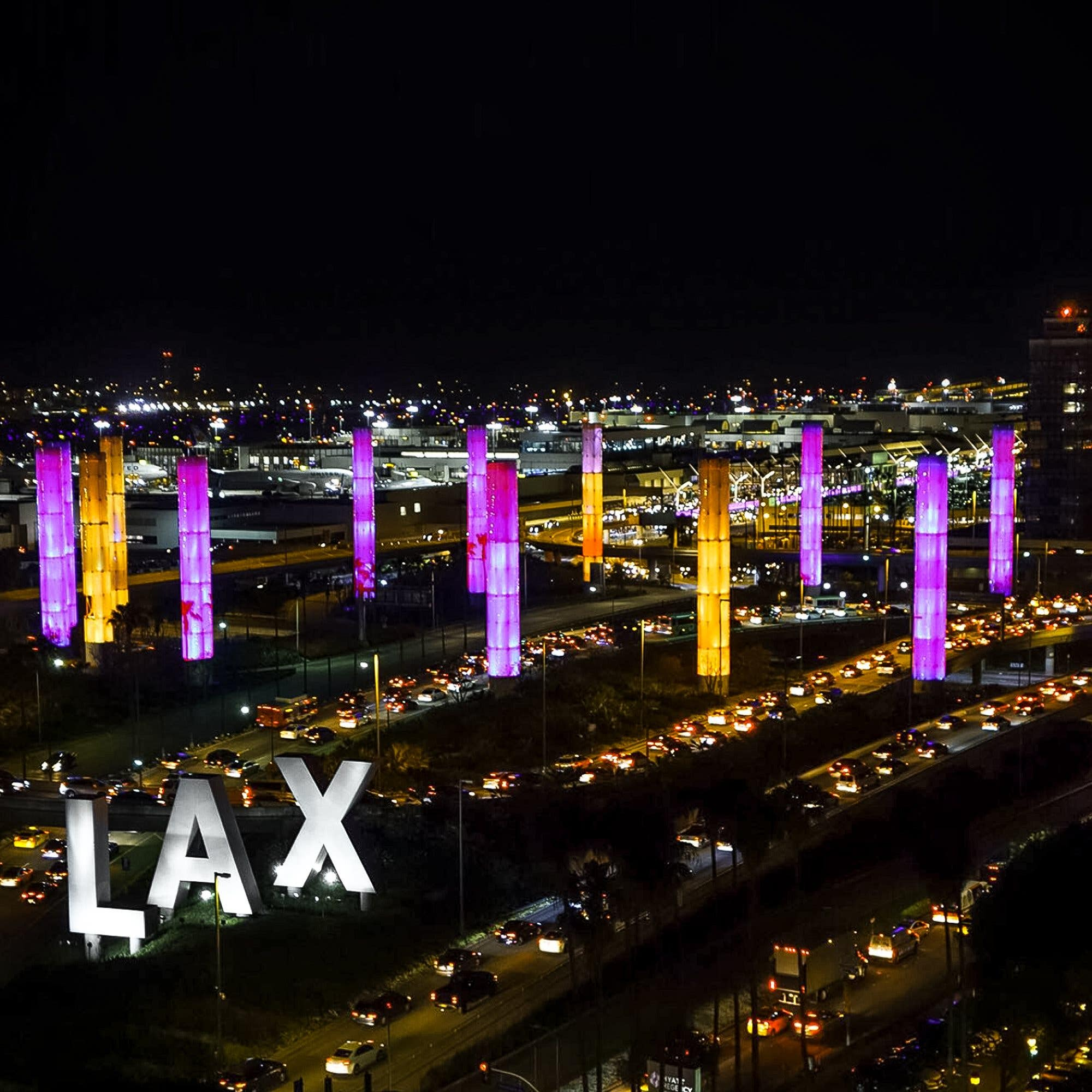 LAX Gateway Pylons are lit up in purple and gold in honor of Kobe Bryant