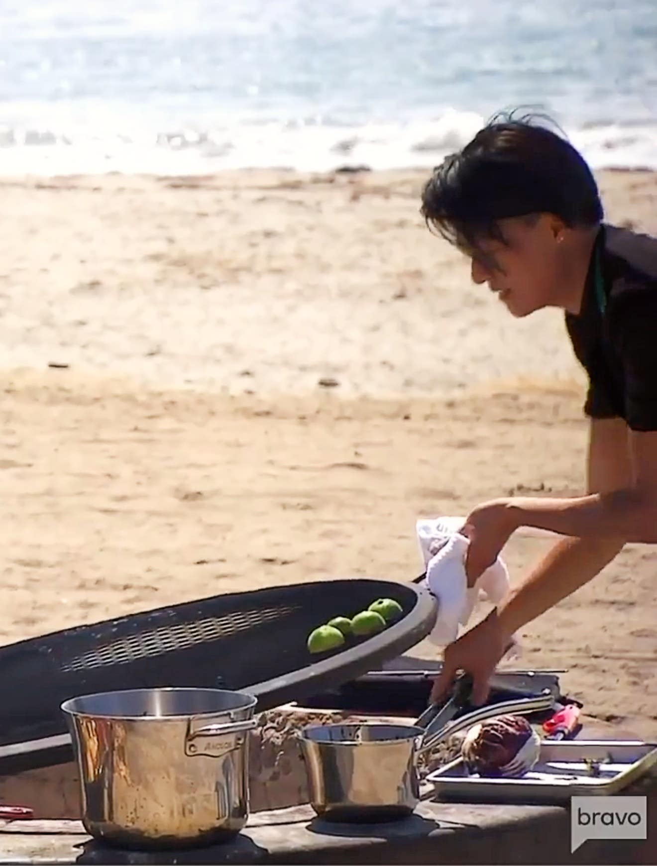 Chef Melissa King grills radicchio in a fire pit at Cabrillo Beach