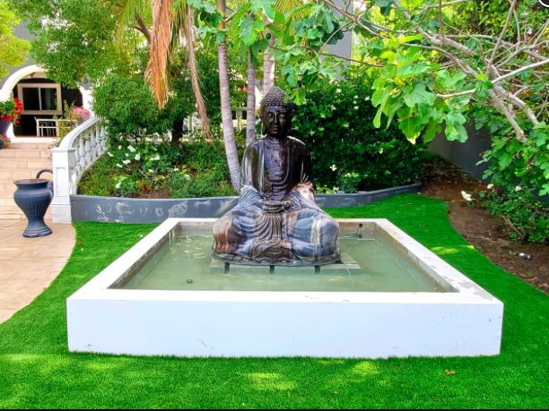Yoga by the Buddha Statue while the warm breeze blows through the air