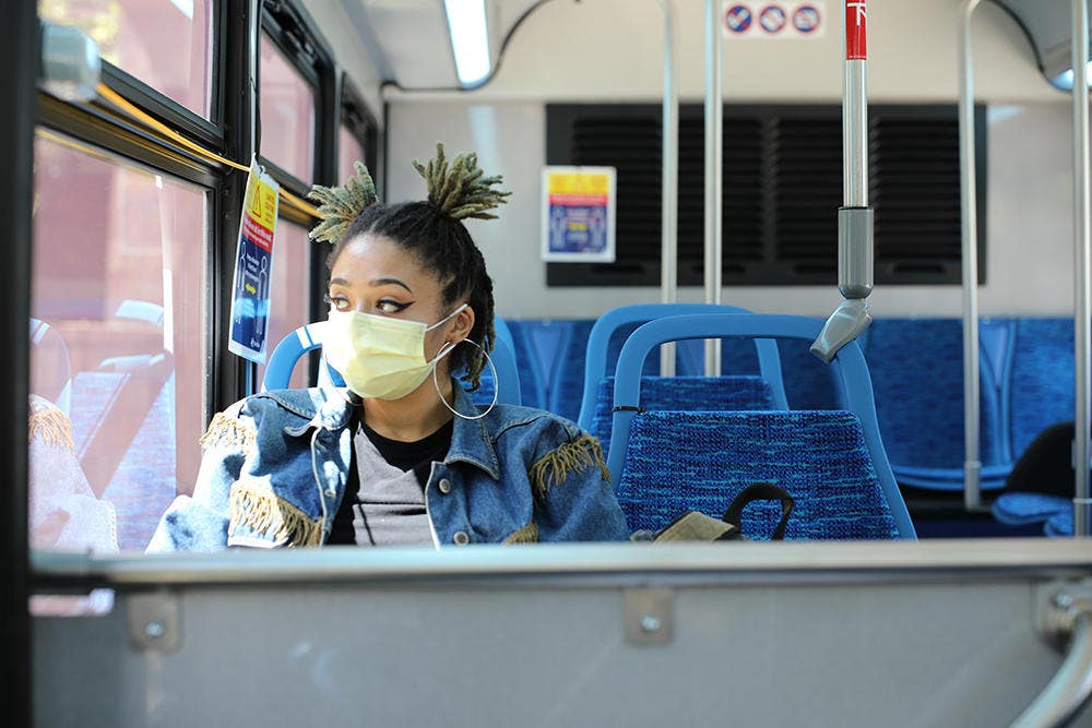 Image of a woman wearing a mask on public transportation