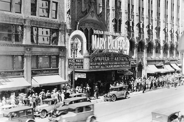 "Crowds line up for Mary Pickford's first talkie, ""Coquette"" at the United Artists Theatre 