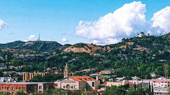 Hollywood Sign and Griffith Observatory viewed from Barnsdall Art Park | Instagram by @ashleyllee.ig