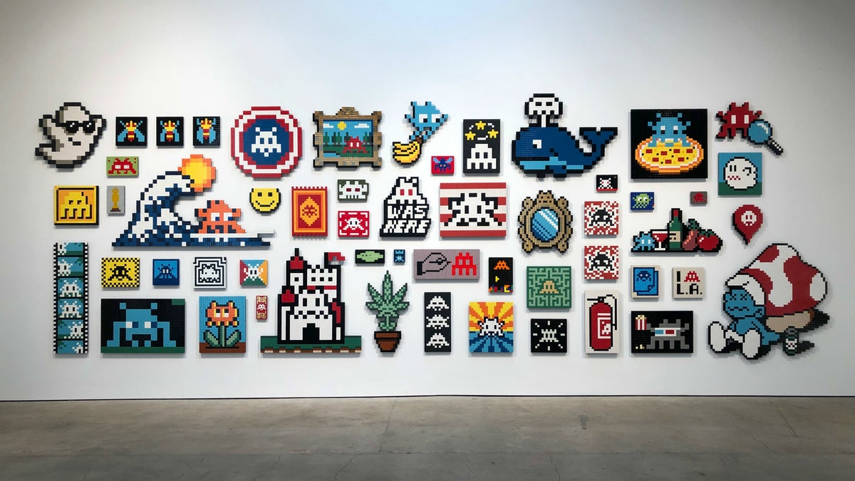 "Wall of aliases by Invader at ""Into the White Cube"" 