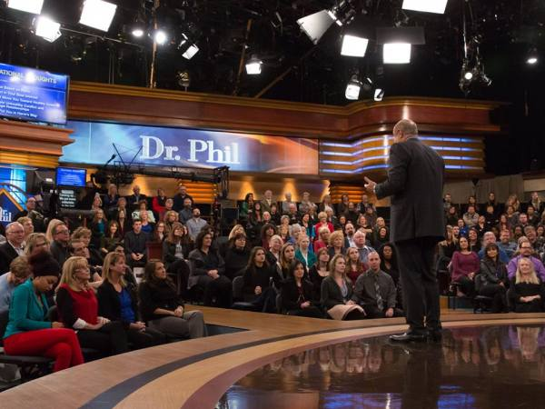 Dr. Phil chats with the studio audience