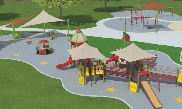 Picture of Shane's Inspiration newly designed playground with separate zones of play equipment. There are accessible pieces with tent covering above it. The playground is on surfacing with stars distributed across and surrounded by green field.
