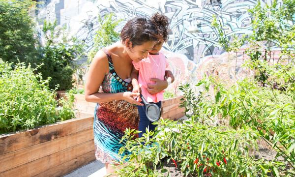 A mother and daughter explore the community garden at Hauser & Wirth Los Angeles.