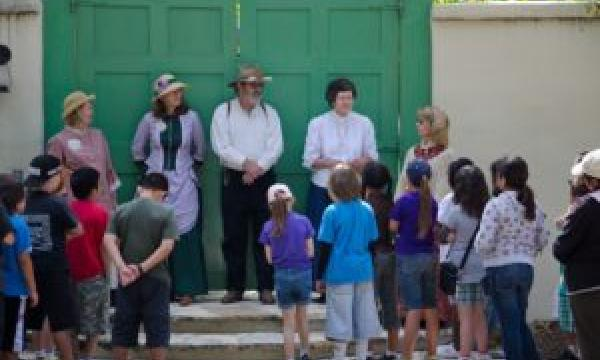 Rancho Los Cerritos hosts a series of school docent training classes starting Thursday, September 12, 2019. (Photo - School Docents dressed in first-person attire about to lead 4th Grade students on a tour of the Rancho.).