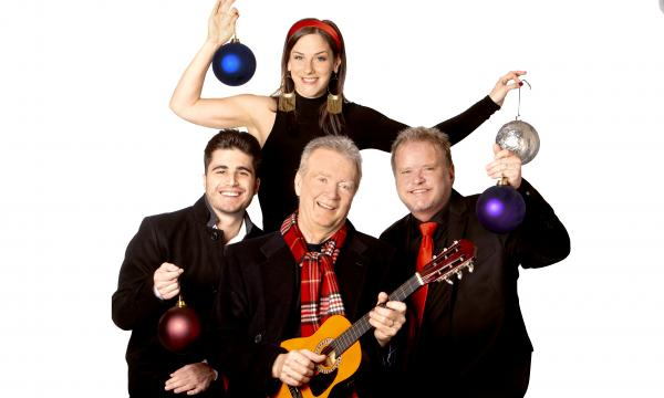 Peter White holding a ukulele with Victor Ingala, Lindsey Webster, and Euge Groove all holding holiday ornaments.