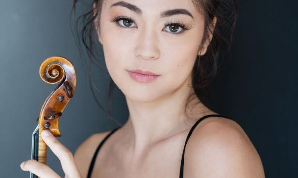 Simone Porter posing with her violin in a close up picture.