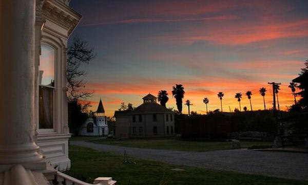 """After the sun goes down, follow a """"Ghost Tour"""" guide on a small-group exploration of the families who once lived in the houses at Heritage Square. Learn about the family history as well as successes and tragedies in this nighttime walk (wear comfortable shoes and are aware of uneven surfaces). Be prepared for other ghost stories along the pathways."""