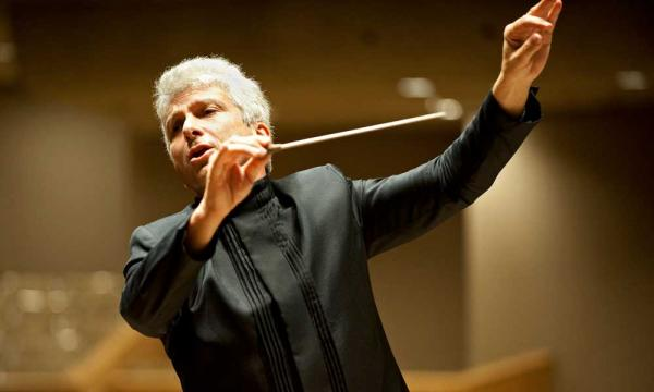 Older man conducting passionately.
