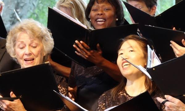 Members of chorale singing.