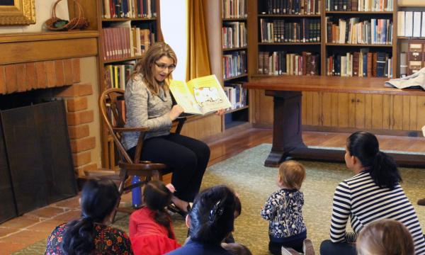 Sarah reading to children in the RLC library