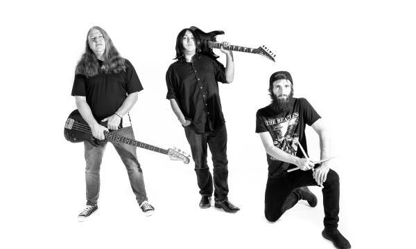 Left to right: Mark Kennedy (bass), Alan Garcia (vocals/guitar), Dustin Walker (drums)