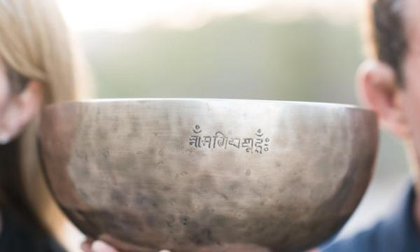 steel bowl with man and woman in background