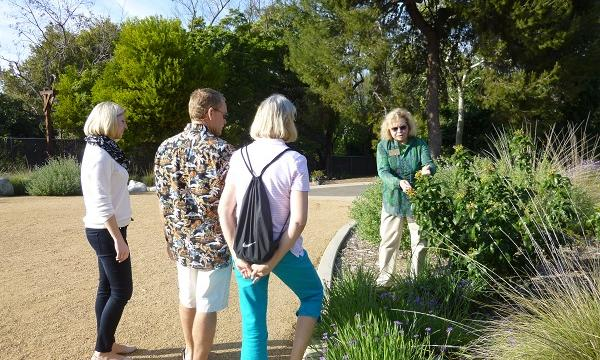 Docent leading three individuals through the garden