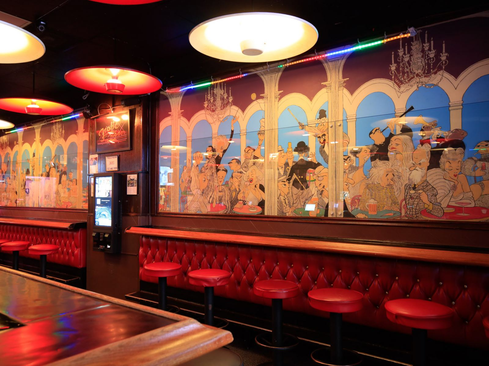 Hirschfeld's famous mural of celebrity caricatures inside the Frolic Room