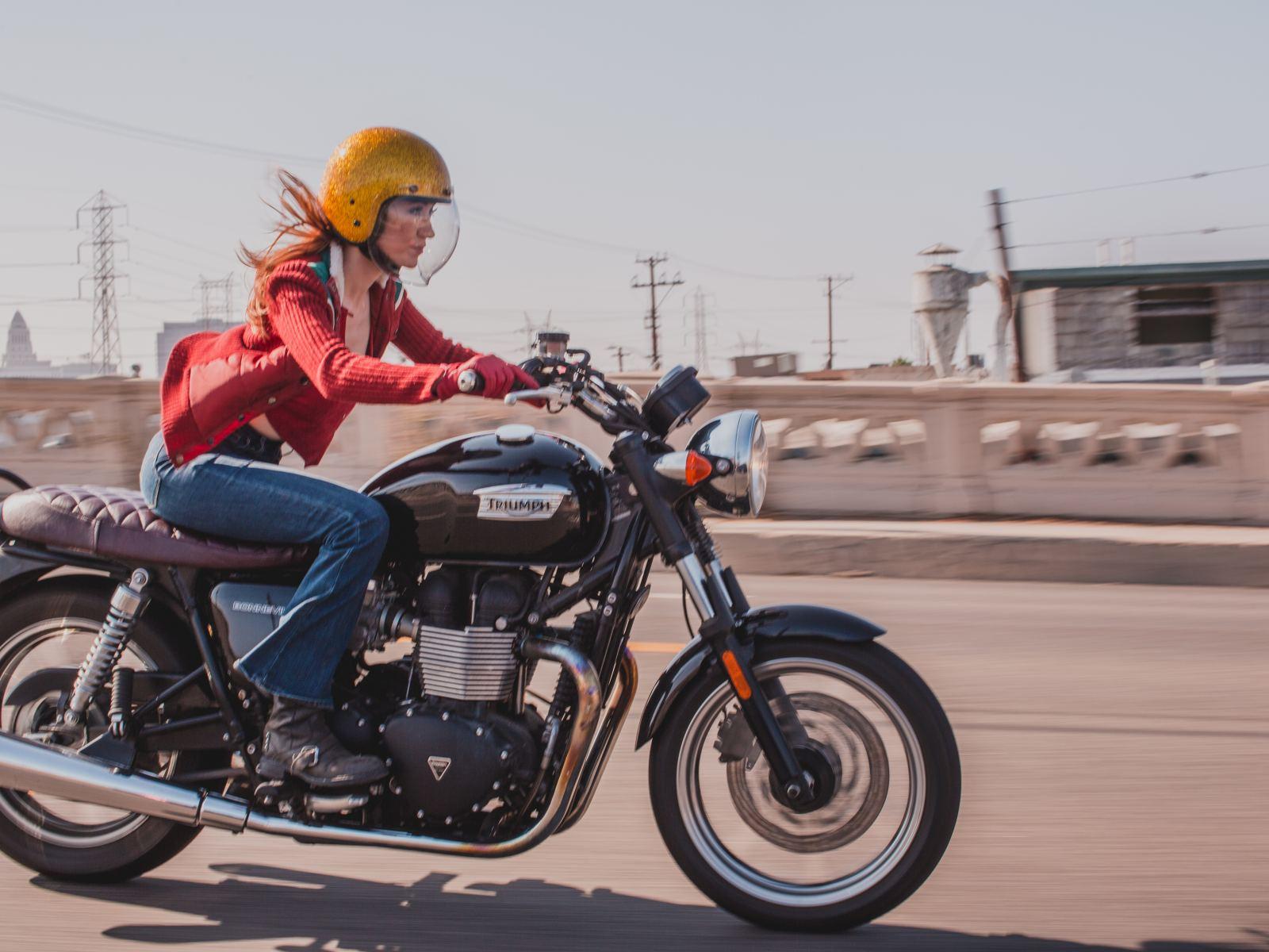 Motorcycle expert Irena Murphy crosses a bridge in Downtown L.A.