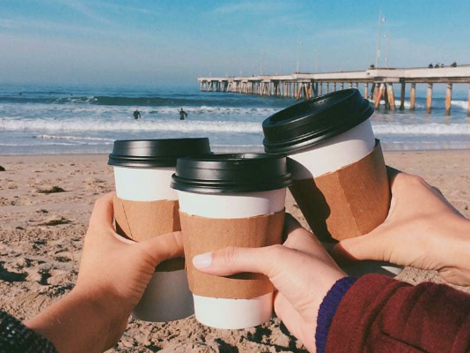 Coffee on the beach from The Cow's End Cafe l Instagram by @washingtonsquarevenice