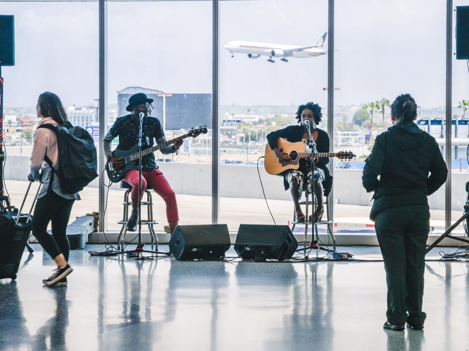 Sunny War performs in LAX Terminal 1 as part of LAX Presents
