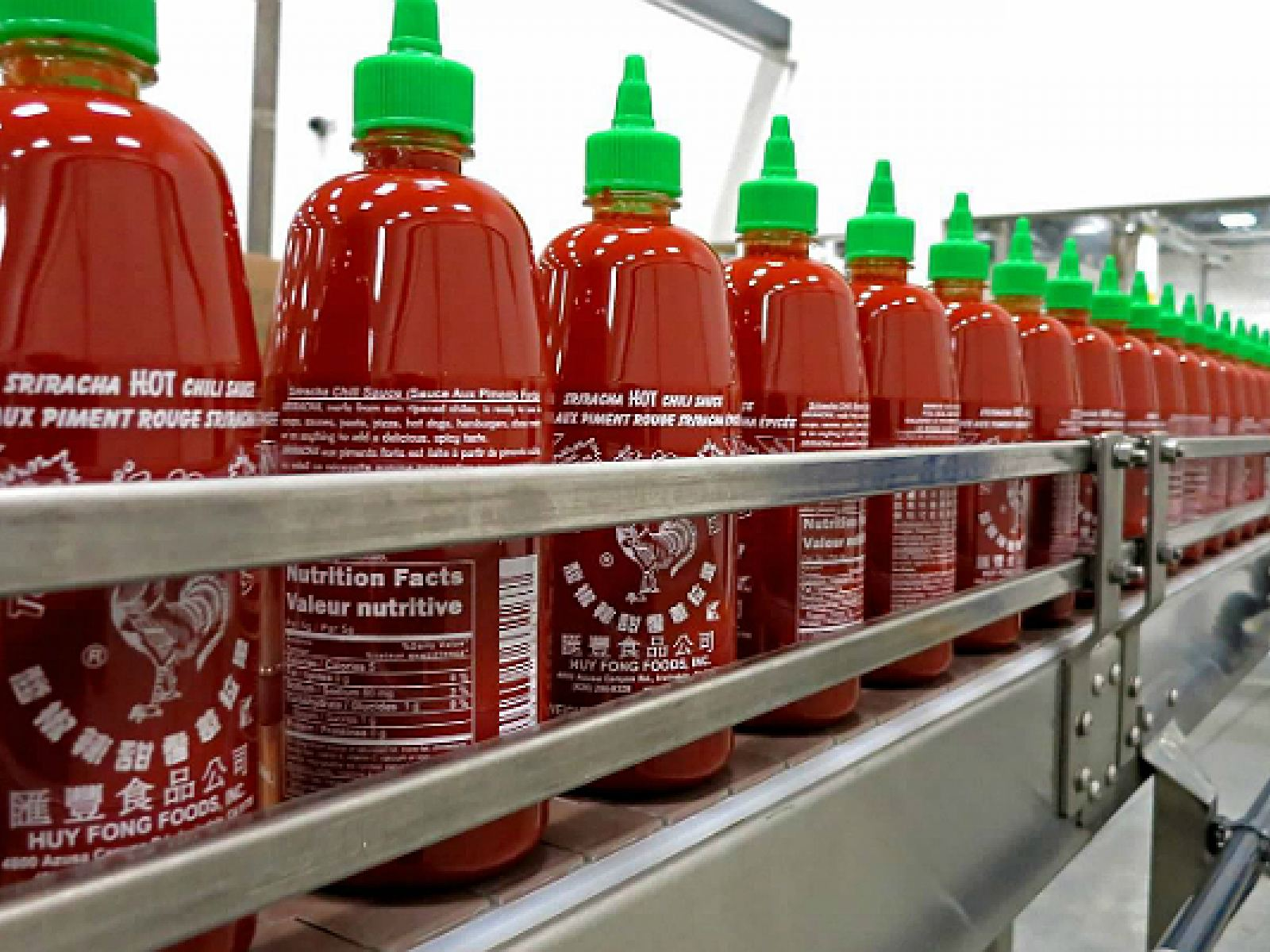 Main image for article titled Go Behind the Scenes with Huy Fong Foods and Sriracha