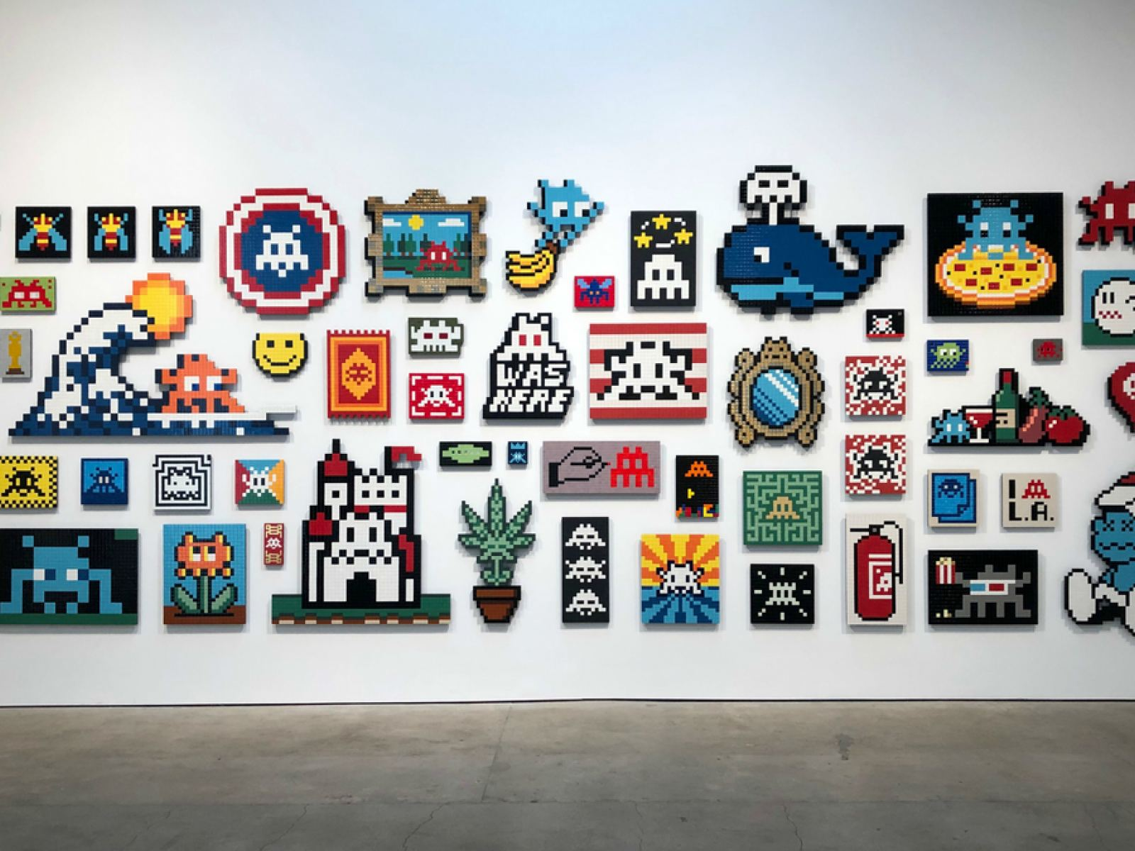 """Wall of aliases by Invader at """"Into the White Cube"""" 