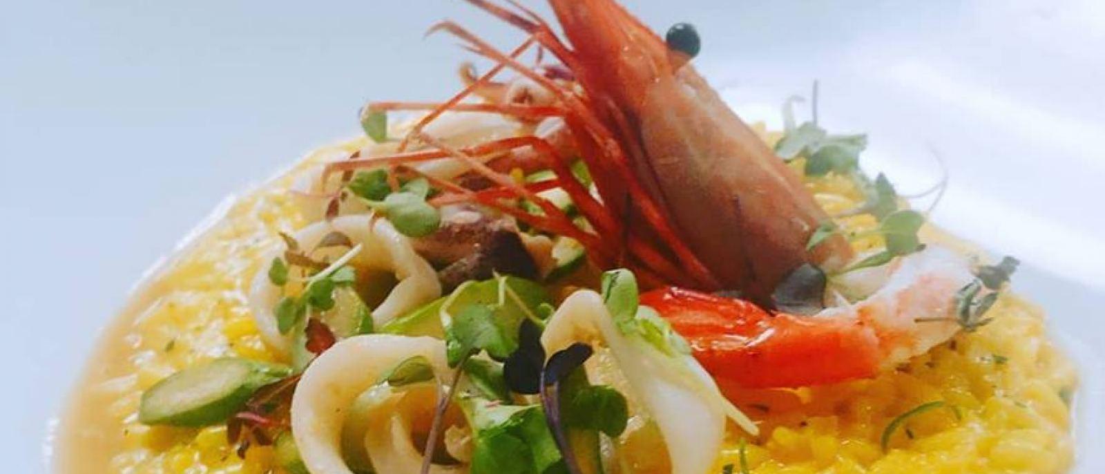 Saffron risotto with Santa Barbara prawns, calamari and asparagus at Drago Centro. Facebook
