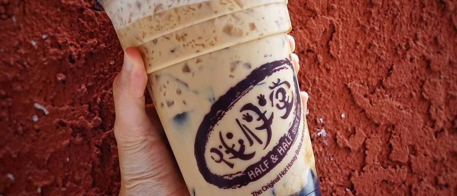 Oolong milk tea with grass jelly and honey boba at Half & Half Tea House in San Gabriel | Instagram by @funfactfoodie