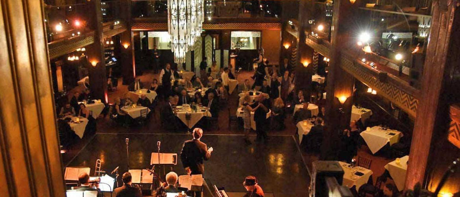 A couple dances at Cicada Restaurant | Photo: Cicada, Facebook
