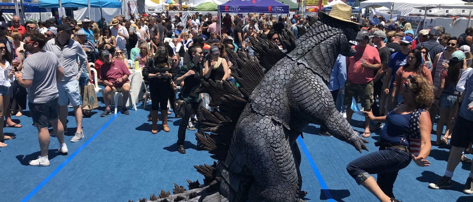 Godzilla dancing at Fiesta Hermosa