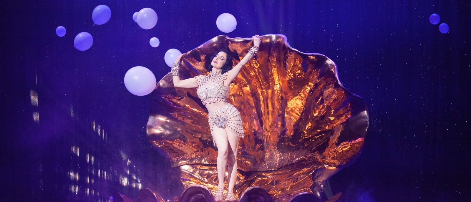 Dita Von Teese on stage in a clam shell