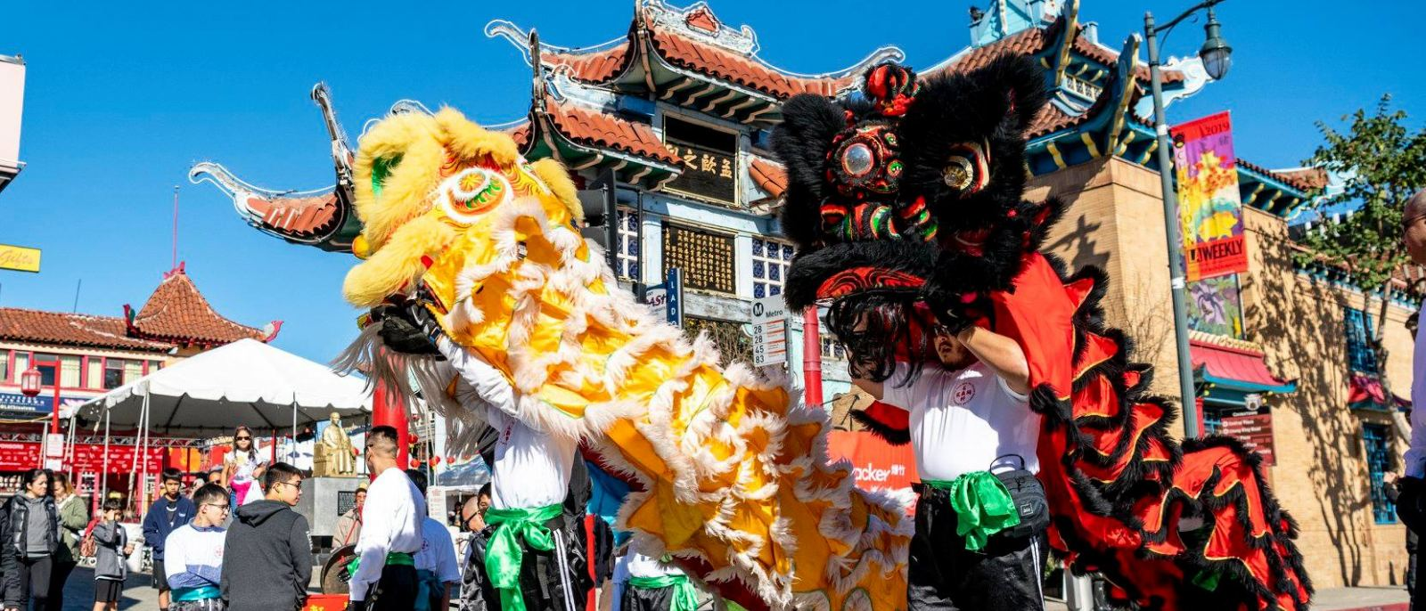 Traditional lion dancers performing on the streets of Chinatown in Downtown LA