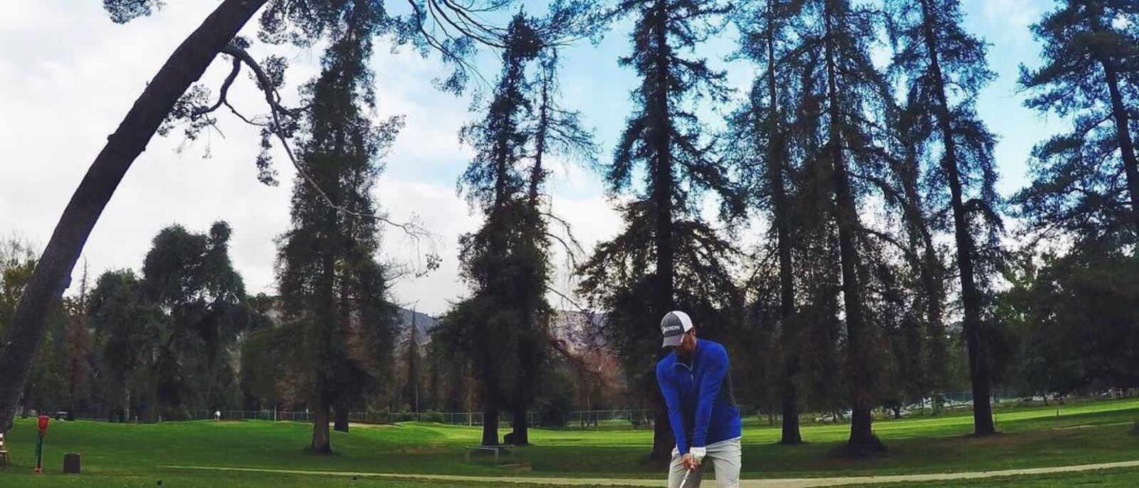 Golfer takes a swing at Harding Golf Course in Griffith Park