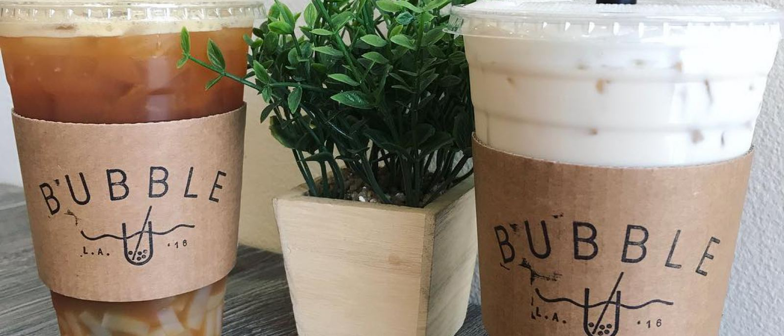 Passion Green Tea with Lychee + Oolong Milk Tea with Boba at Bubble U | Instagram by @kat.eats_