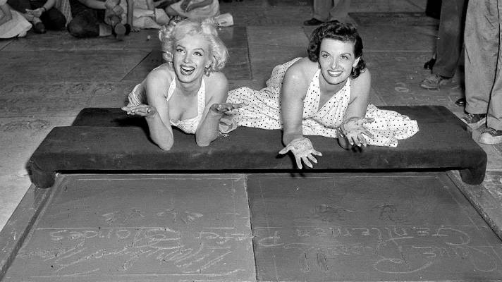 Marilyn Monroe and Jane Russell leave their handprints in the Forecourt of the Stars (June 26, 1953)   Photo courtesy of TCL Chinese Theatre, Facebook