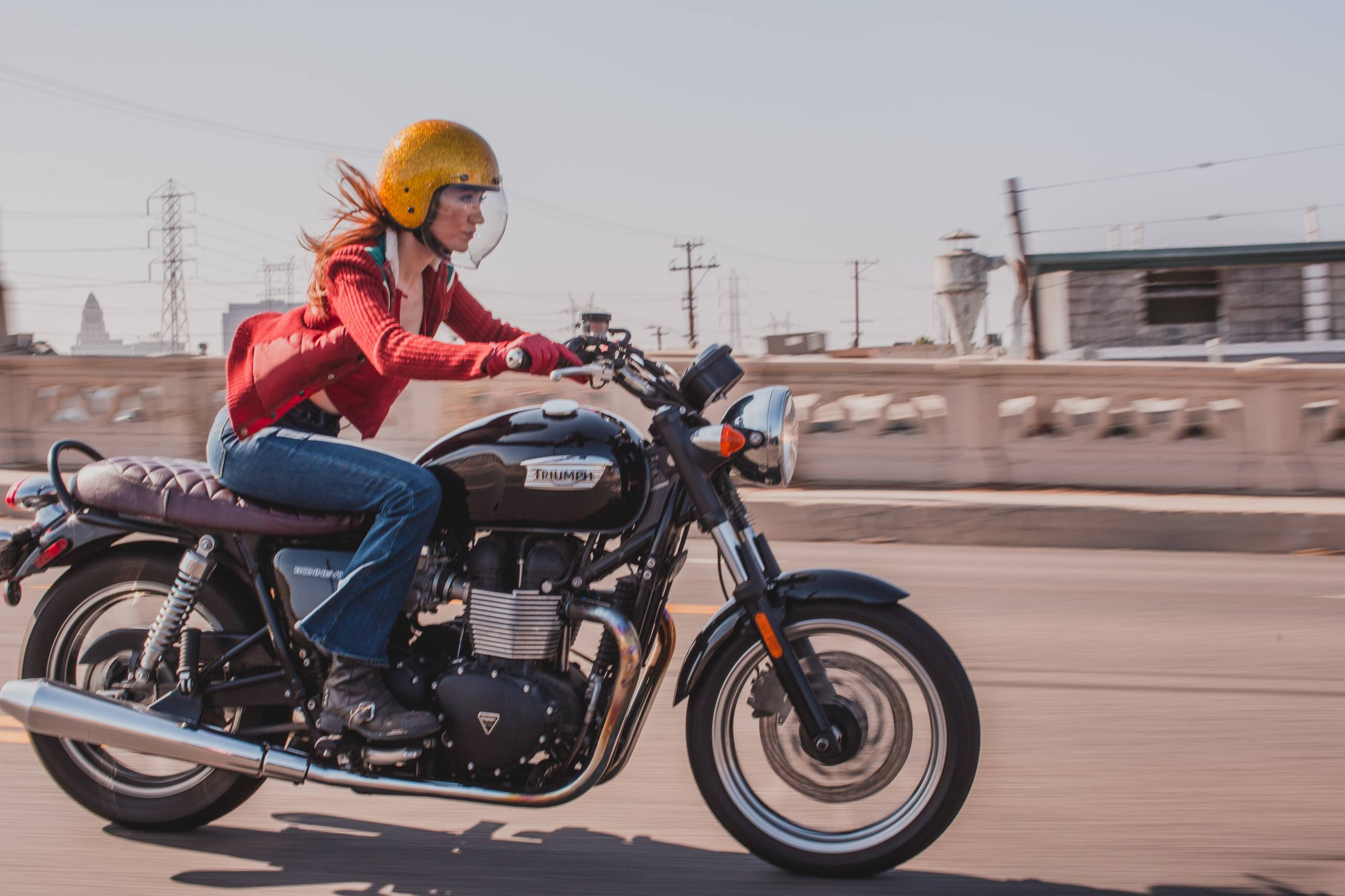 Motorcycle expert Irena Murphy crosses a bridge in Downtown L.A.